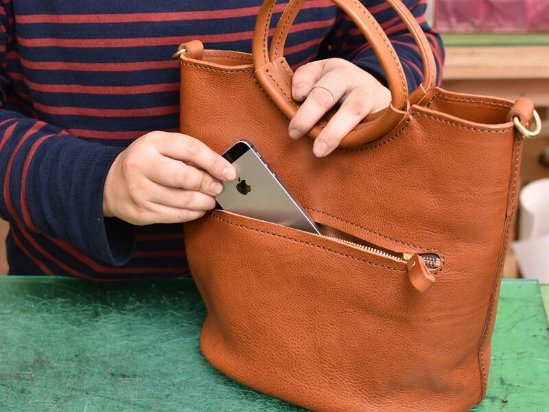 リング取っ手のハンドバッグ ポケット