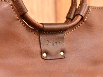 リング取っ手のハンドバッグ カスターニョ刻印