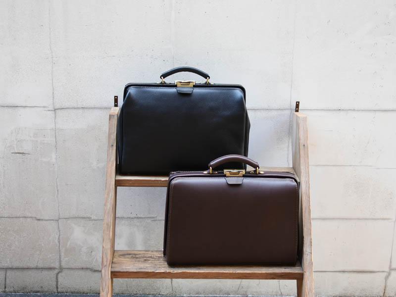 ダコタとホリディ 口枠タイプの一本手ビジネスバッグ